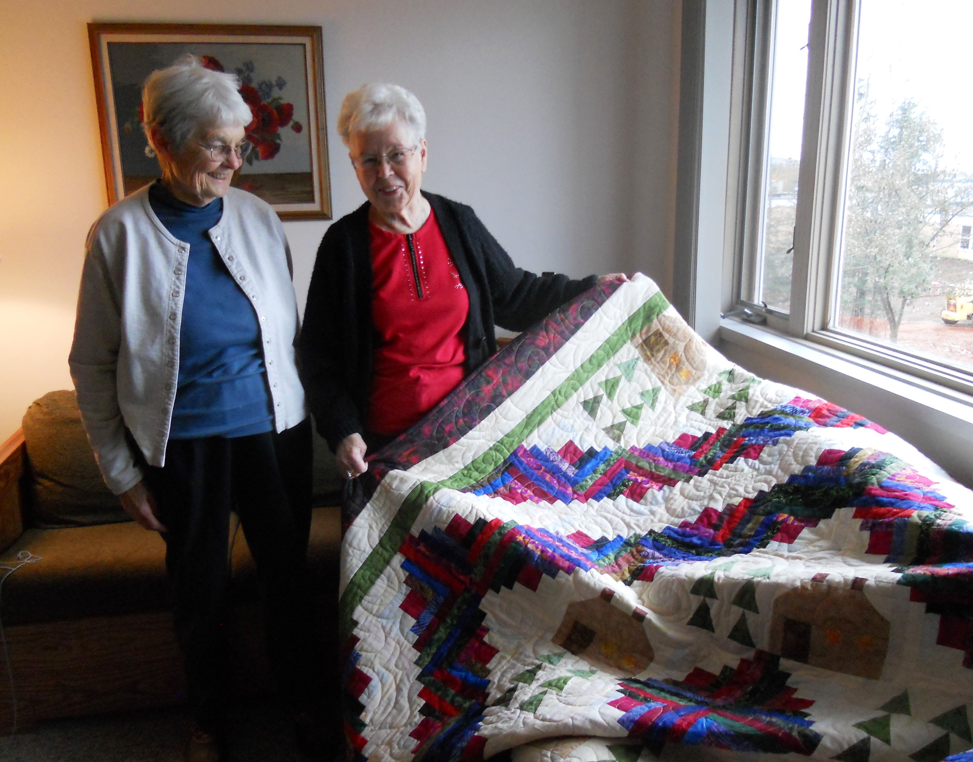Carol Harris' quilt raised $1660 through our quilt raffle in 2015. Local resident, Lori Thompson (right) was the luck winner. Look for another Care Partners Quilt Raffle this summer!