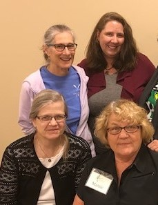 Dr. Stover (front, left),  Jayne Johnson (behind), Care Partners staff: Marnie Hovland (front),  Kelly Holtzman